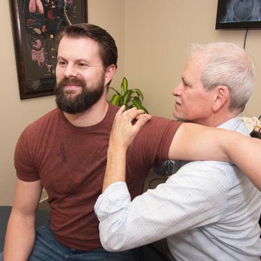 Dr. Mark adjusting shoulder