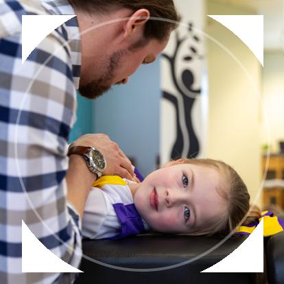 Dr. Connor adjusting child