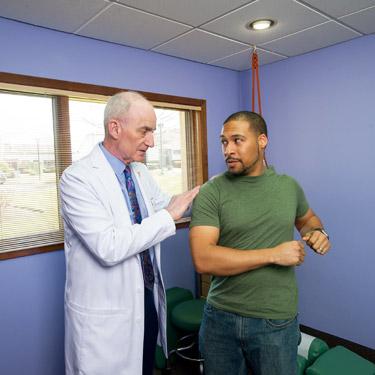 Doc examining patient posture
