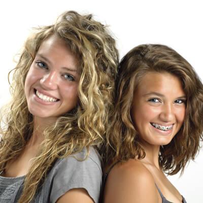 Two teenage girls - one wearing braces