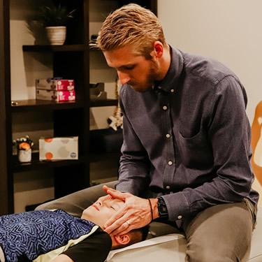 Dr Madsen adjusting boy