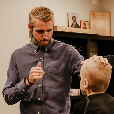 Dr. Madsen examining boy