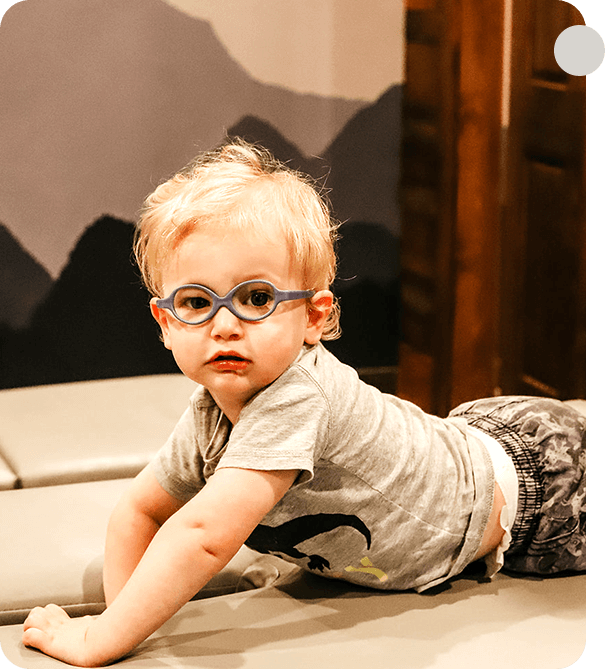 Little boy laying on adjusting table