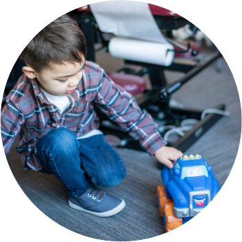 Child playing with toy truck