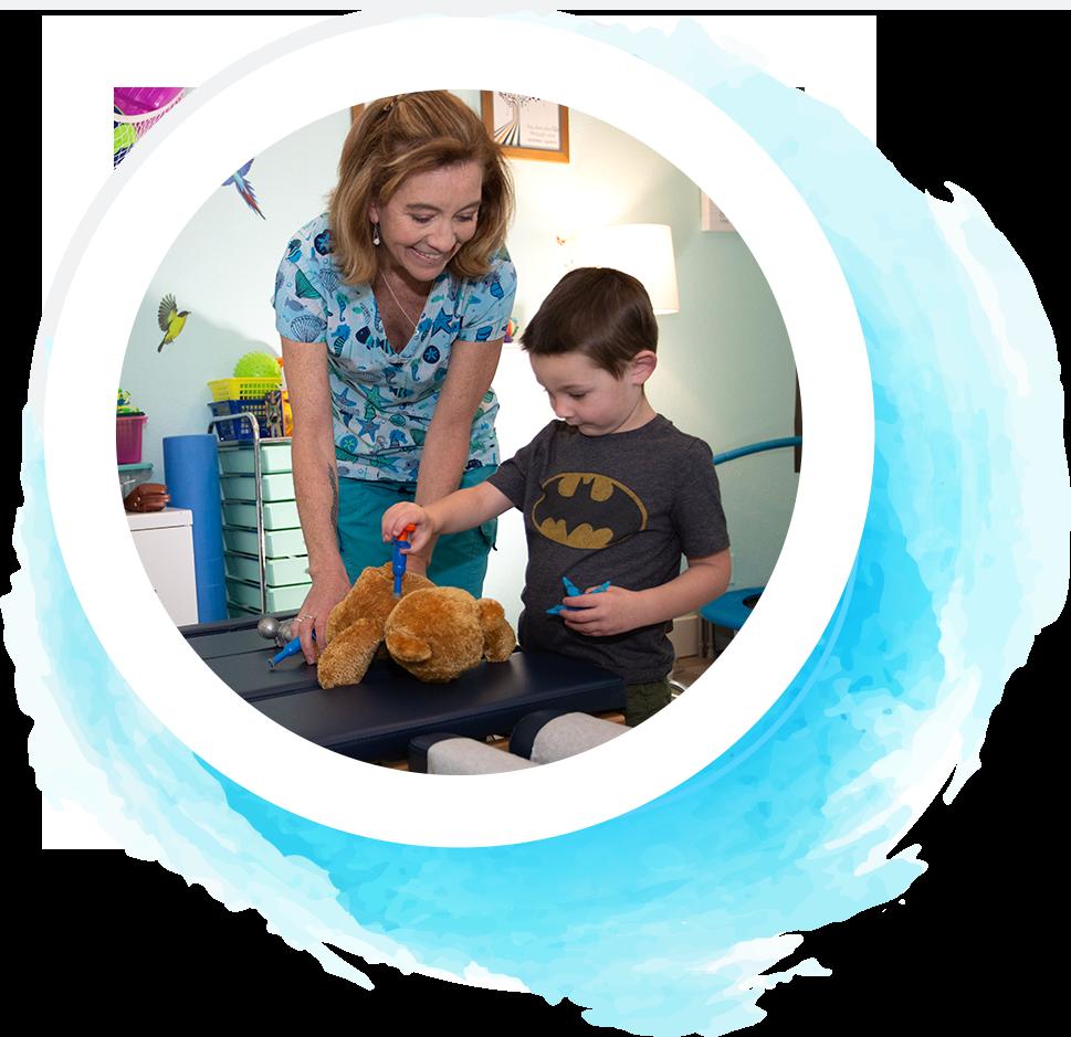 Dr. Lisa and child adjusting bear