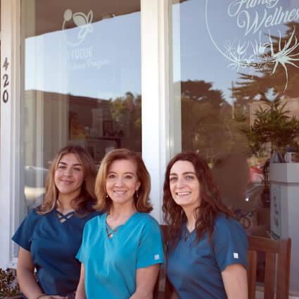 Coastal Family Wellness team by window