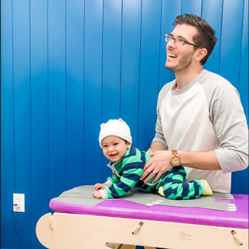 Dr. Max with infant patient