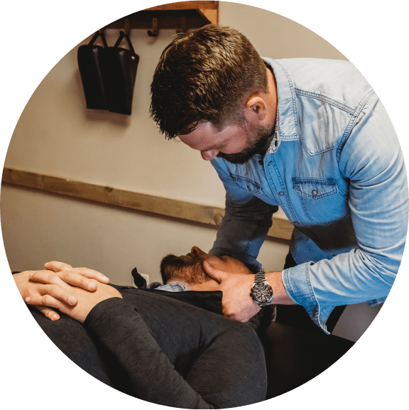 Chiropractor Castle Rock, Dr. Joseph Schmidt adjusting man