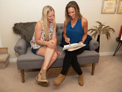 Nikki reviewing paperwork with client
