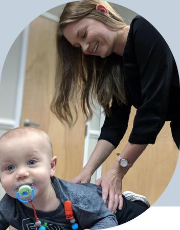 Dr. Melissa adjusting baby