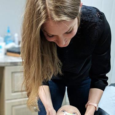 Dr Melissa adjusting baby
