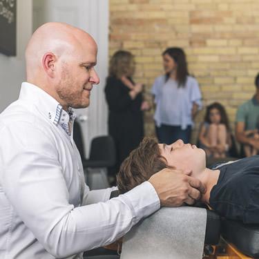 Dr. Joel adjusting teen