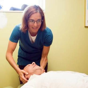 Dr. Elizabeth adjusting mans neck