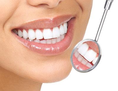 Woman's Teeth in Mirror