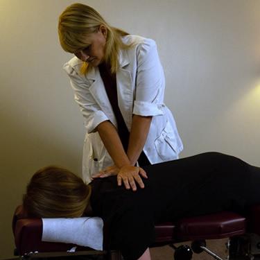 Dr Nicole adjusting woman