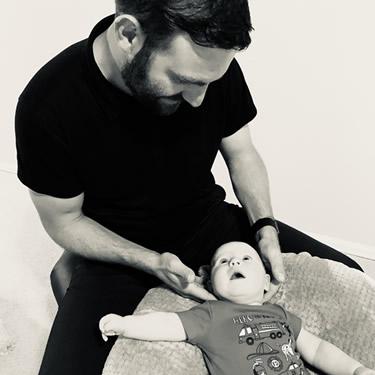 Dr. Aaron adjusting baby