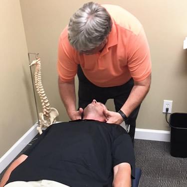 Dr Massey adjusting mans neck