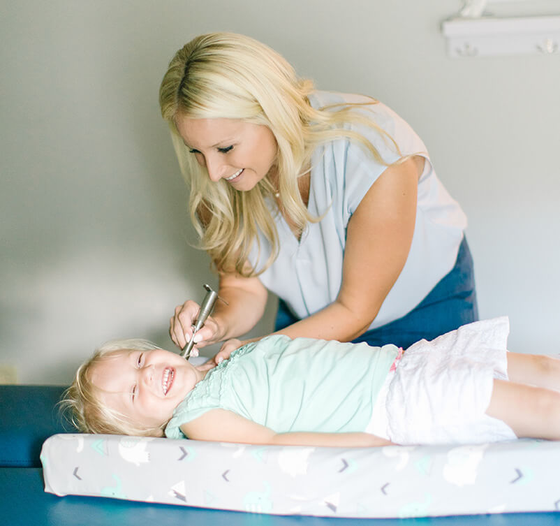 Dr. Lauren adjusting child