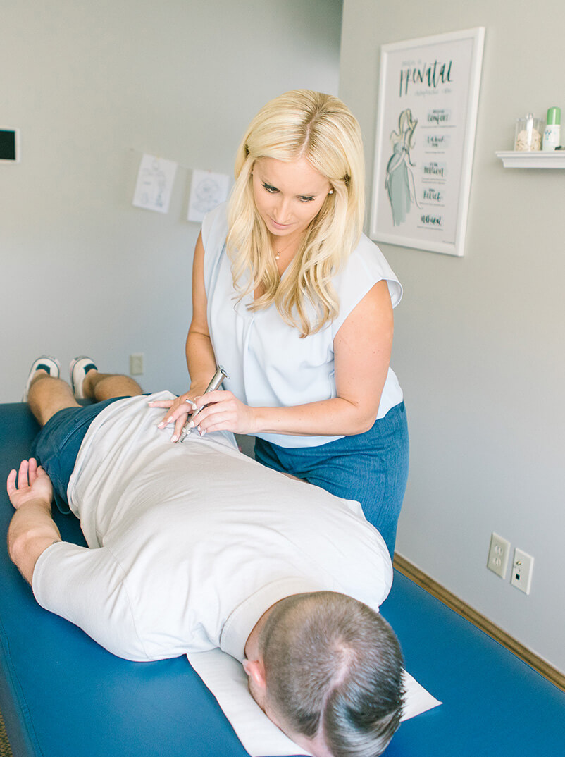Dr. Lauren adjusting patient