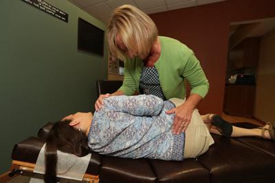 Dr. Becker adjusting woman