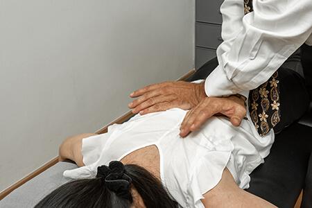 Chiropractor adjusting patient's back