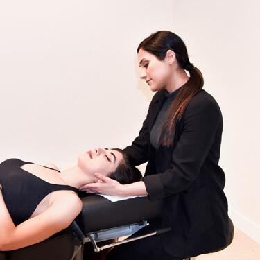 Dr Natalie adjusting patient