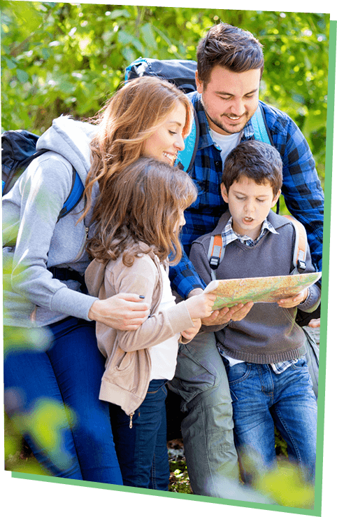 Family looking at map
