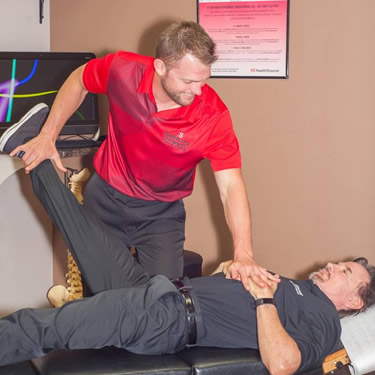 Dr. Ryan adjusting patient leg