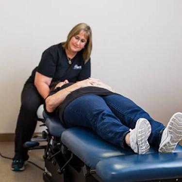 Dr. McClellan adjusting patient