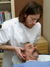 Dr. Brian Quinn adjusts a patient.