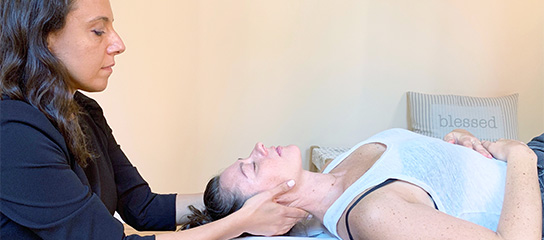 Dr Sura adjusting woman
