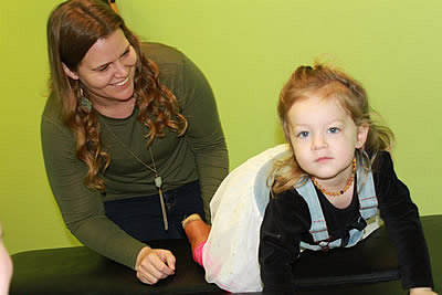 Dr. Carolyn looking at young girl