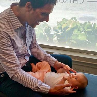 Dr Jack adjusting baby