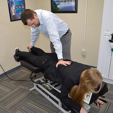 Dr Cline adjusting patient
