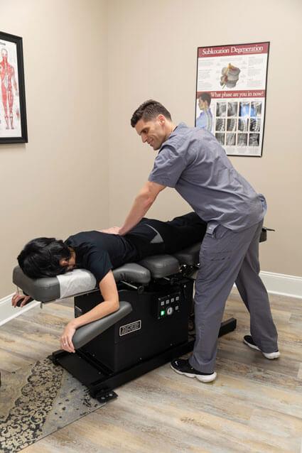 Chiropractic adjustment by Dr. Broadus
