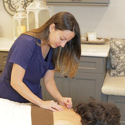 Dr. Amanda performing acupuncture