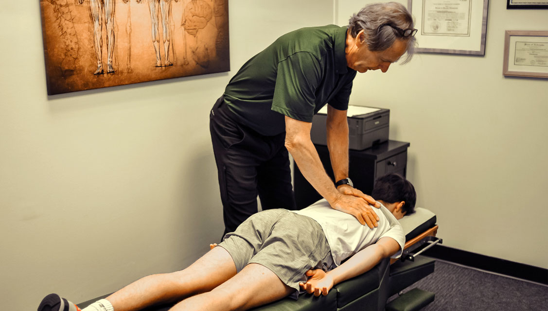 Dr. Joe adjusting patient