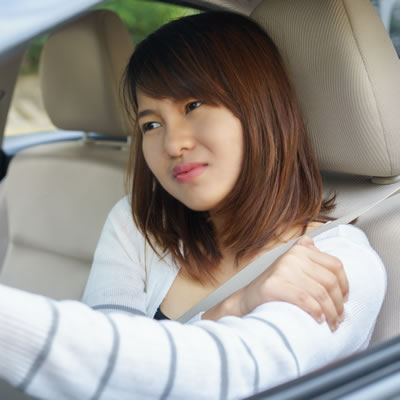 Woman in a car after minor accident