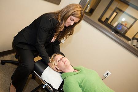 Dr. Darcey adjusting woman neck