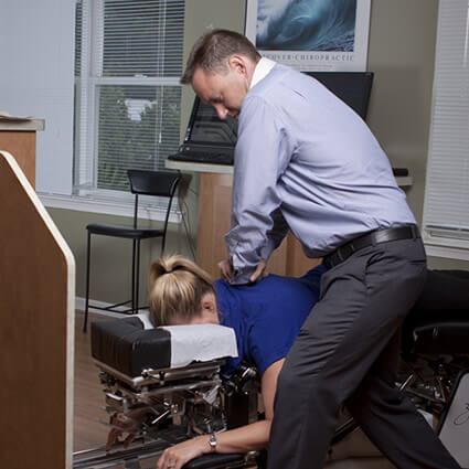Dr. Keith adjusting patient