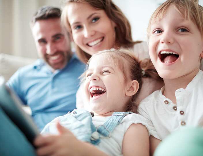 Family with 2 little girls laughing
