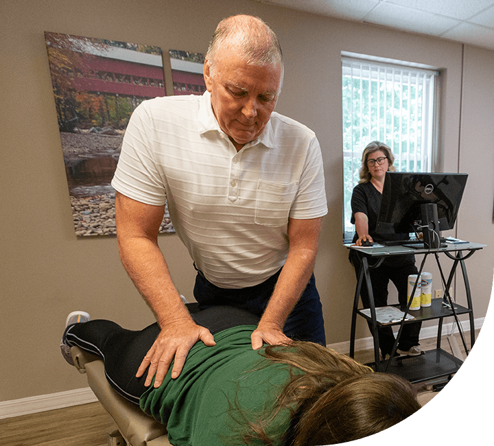 Dr. Graham adjusting patient