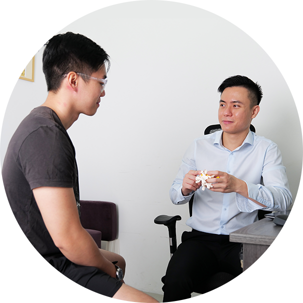 Chiropractor talking to patient