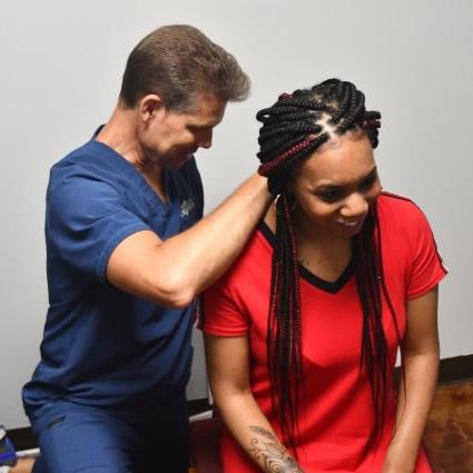 Doc examining patient