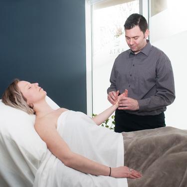 Chris massaging patient