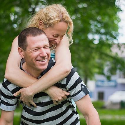 adult couple piggyback