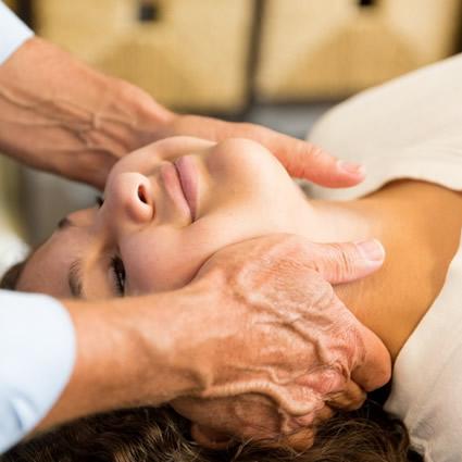 Women getting neck adjustment