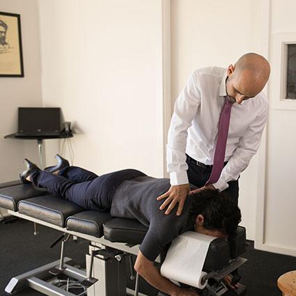 Dr. Mario adjusting womans back