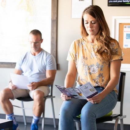 Patient reading brochure
