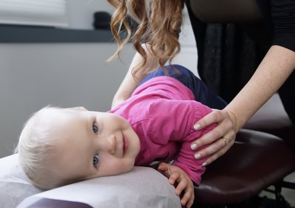 Baby girl getting adjusted
